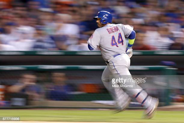 Rene Rivera of the New York Mets hits a single during the seventh inning against the Chicago Cubs at Wrigley Field on July 19 2016 in Chicago Illinois