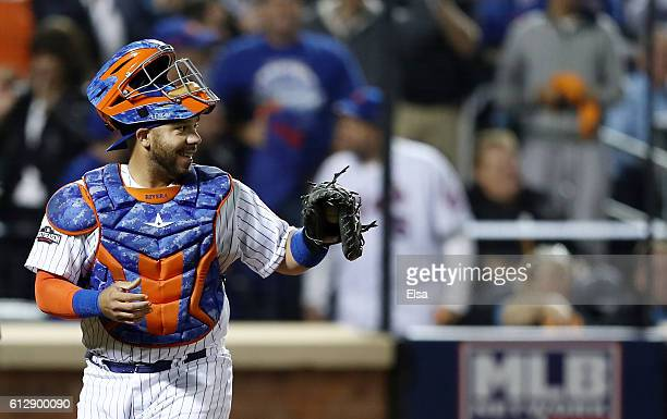 Rene Rivera of the New York Mets reacts after Angel Pagan of the San Francisco Giants struck out in the second inning during their National League...