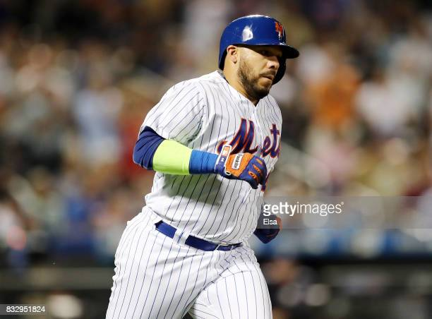 Rene Rivera of the New York Mets rounds the bases after he hit a solo home run in the fifth inning against the New York Yankees during interleague...