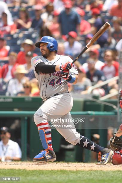 Rene Rivera of the New York Mets takes a swing during a baseball game against the Washington Nationals at Nationals Park on July 4 2017 in Washington...