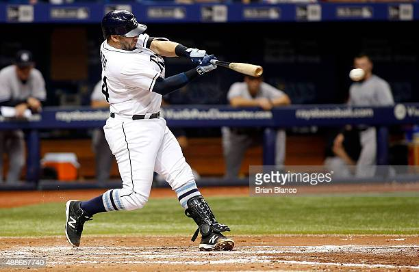 Rene Rivera of the Tampa Bay Rays hits a single to left field during the fifth inning of a game against the New York Yankees on September 16 2015 at...