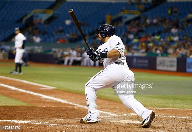 Rene Rivera of the Tampa Bay Rays hits a walk off RBI single to score Tim Beckham during the bottom of the ninth inning of a game against Boston Red...
