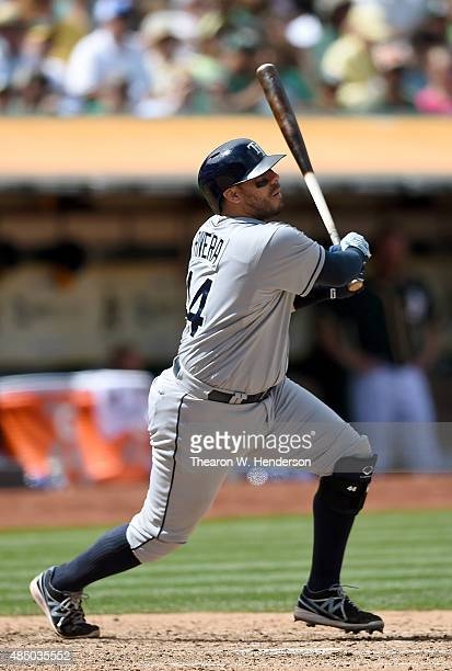 Rene Rivera of the Tampa Bay Rays hits and rbi single scoring Asdrubal Cabrera against the Oakland Athletics in the top of the seventh inning at Oco...