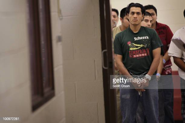 Rene RomanNavarrete waits with other undocumented immigrants at the US Immigration and Customs Enforcement processing facility before being...