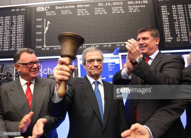Rene Schuster CEO of German branch of Spanish phone company Telefonica O2 and CEO of Deutsche Boerse Reto Francioni applaud as CEO of Telefonica...