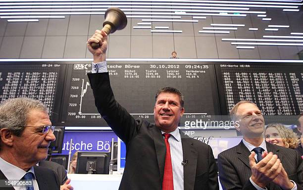 Rene Schuster CEO of German branch of Spanish phone company Telefonica O2 waves the bell during the company's Initial Public Offering at the stock...
