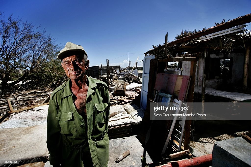 Rene Tejera Marino stands next to what is left of his house in the Playa Caletones community after Hurricane Ike tore through a week earlier...