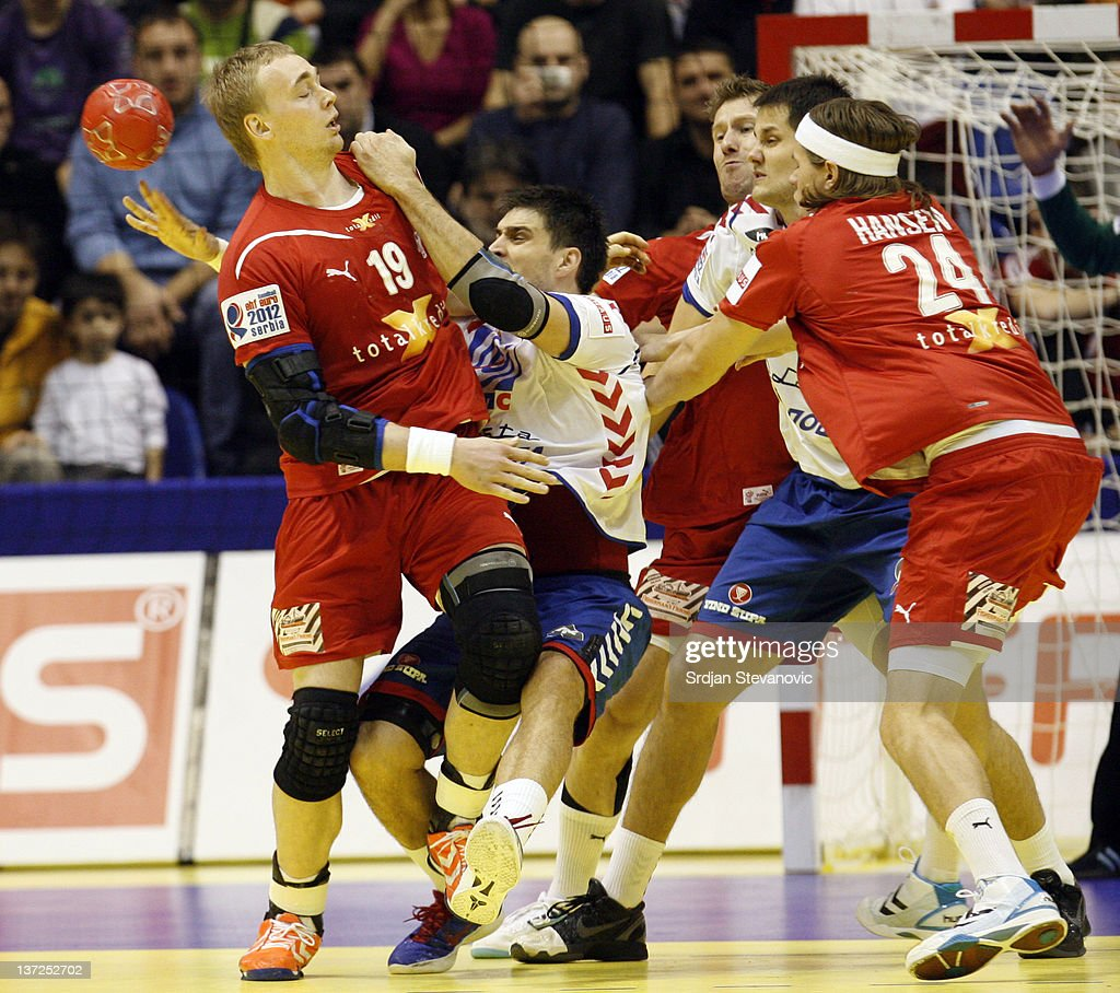 Rene Toft Hansen (R) of Denmark competes with Nenad Vuckovic (L) of Serbia during the Men's European Handball Championship 2012 group A match between Serbia and Denmark at Pionir Arena on January 17, 2011 in Belgrade, Serbia.