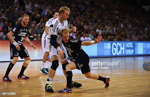 Rene Toft Hansen of Kiel challenges Anders Zacharaissen of Flensburg during the DKB Handball Bundeslga match between SG FlensburgHandewitt and THW...