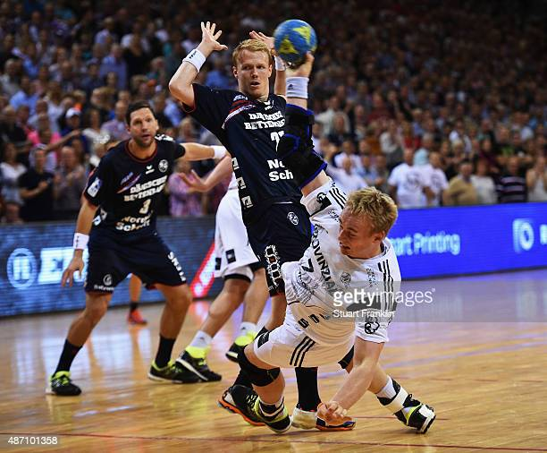 Rene Toft Hansen of Kiel is challenged by Rasmus Lauge of Flensburg during the DKB Handball Bundeslga match between SG FlensburgHandewitt and THW...