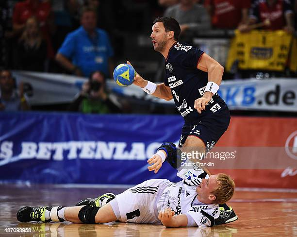 Rene Toft Hansen of Kiel is challenged by Tobias Karlsson of Flensburg during the DKB Handball Bundeslga match between SG FlensburgHandewitt and THW...