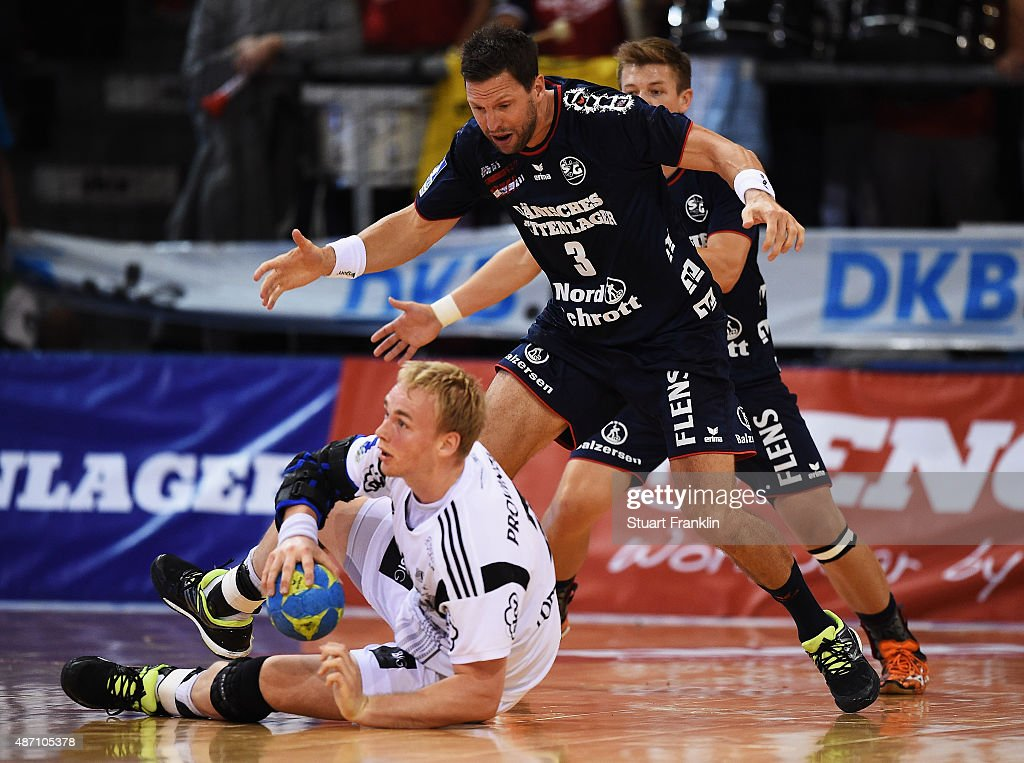 Rene Toft Hansen of Kiel is challenged by Tobias Karlsson of Flensburg during the DKB Handball Bundeslga match between SG Flensburg-Handewitt and THW Kiel at Flens-Arena on September 6, 2015 in Flensburg, Germany.