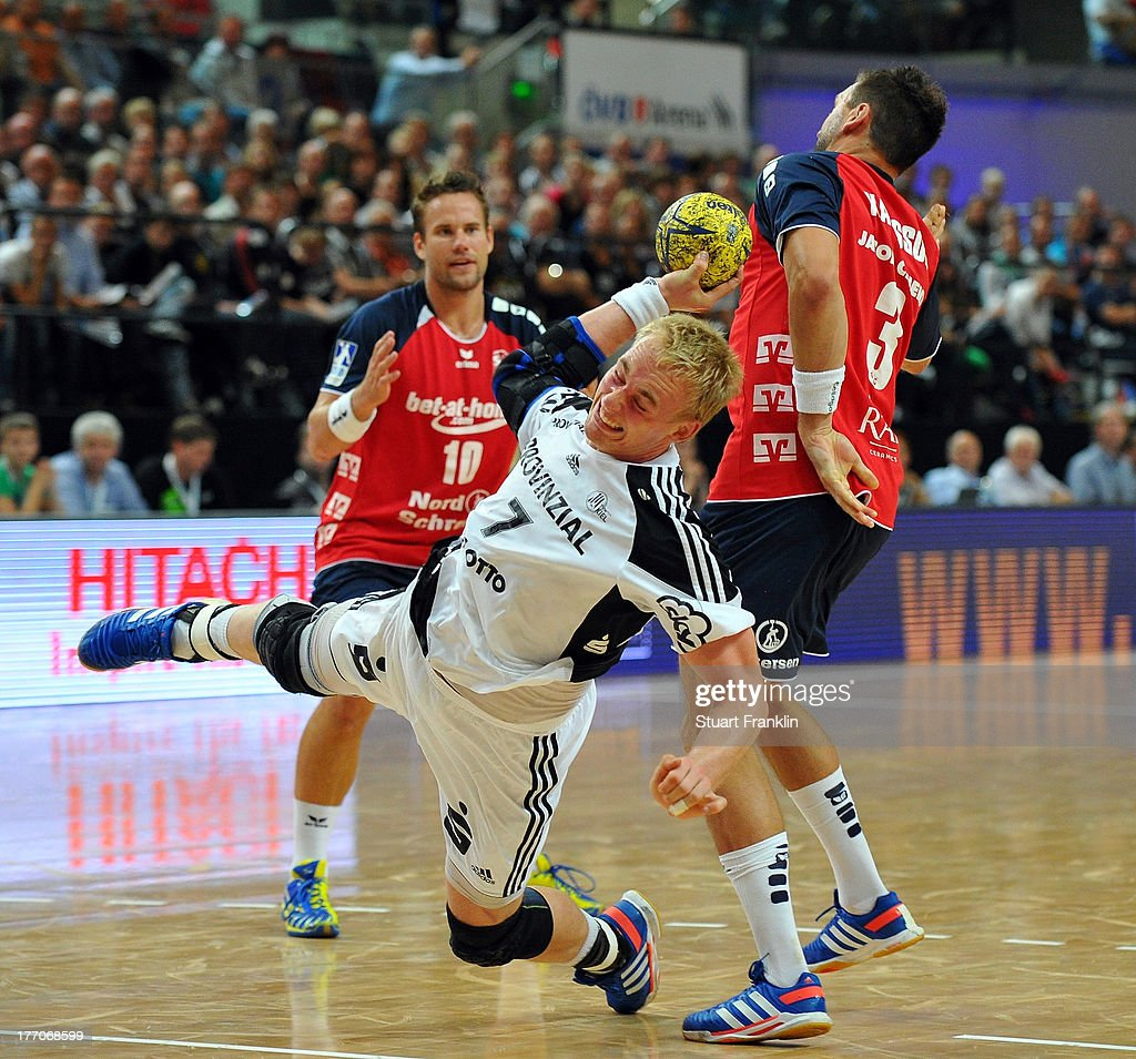Rene Toft Hansen of Kiel throws a goal during the DKB supercup match between THW Kiel and Flensburg Handewitt at the OVB arena on August 20, 2013 in Bremen, Germany.