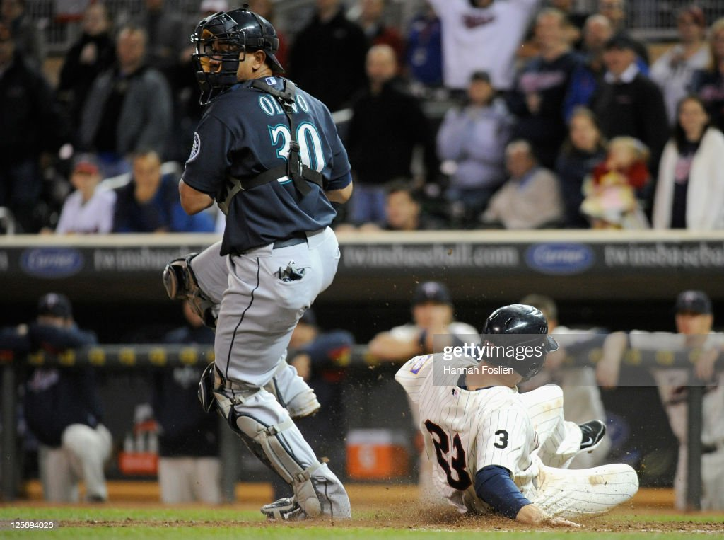 Rene Tosoni #23 of the Minnesota Twins is forced out at home by <a gi-track='captionPersonalityLinkClicked' href=/galleries/search?phrase=Miguel+Olivo&family=editorial&specificpeople=209185 ng-click='$event.stopPropagation()'>Miguel Olivo</a> #30 of the Seattle Mariners in the ninth inning on September 20, 2011 at Target Field in Minneapolis, Minnesota. The Mariners defeated the Twins 5-4.