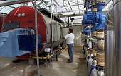 Rene Van Wingerden center uses natural gas boilers to heat the 25 acres of greenhouses where he grows flowers in Carpinteria CA The boiler is...