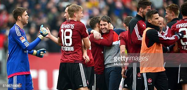 Rene Weiler head coach of Nuernberg celebrates his teams victory with his players after the Second Bundesliga match between 1 FC Nuernberg and RB...