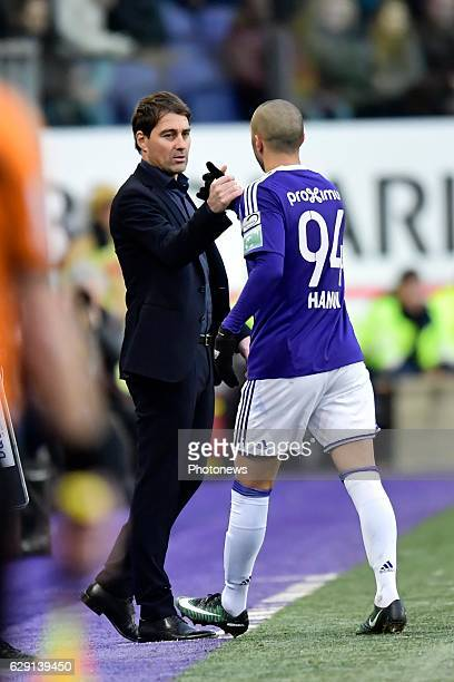 Rene Weiler head coach of RSC Anderlecht shakes his hands with Sofiane Hanni midfielder of RSC Anderlecht after his substitution during the Jupiler...