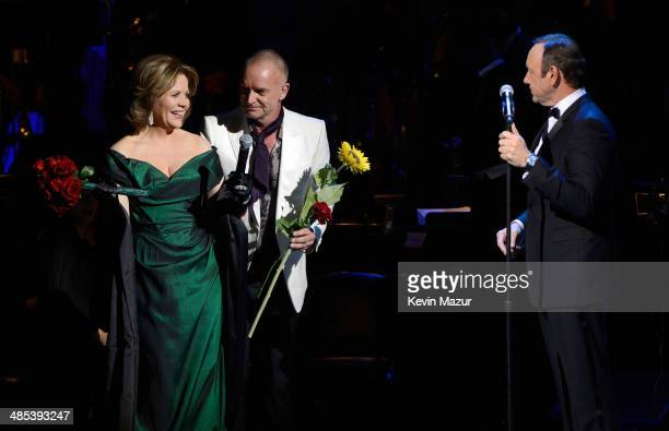 Renee Fleming Sting and Kevin Spacey perform onstage during The 2014 Revlon Concert For The Rainforest Fund at Carnegie Hall on April 17 2014 in New...
