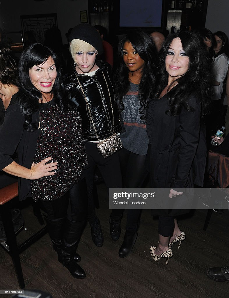 <a gi-track='captionPersonalityLinkClicked' href=/galleries/search?phrase=Renee+Graziano&family=editorial&specificpeople=7643222 ng-click='$event.stopPropagation()'>Renee Graziano</a> and Richie Rich and Meeka Claxton and Chantelle Warr backstage before the Chantilly Rich and Rich War show during Fall 2013 Mercedes-Benz Fashion Week at The Hudson Bond on February 14, 2013 in New York City.