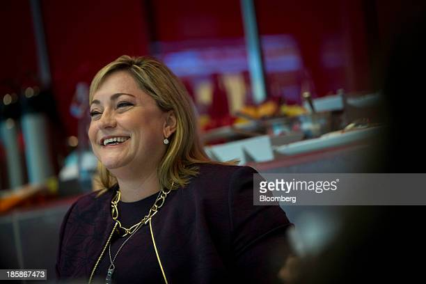 Renee James president of Intel Corp laughs during an interview in New York US on Friday Oct 25 2013 Intel Corp's failure to break into the...
