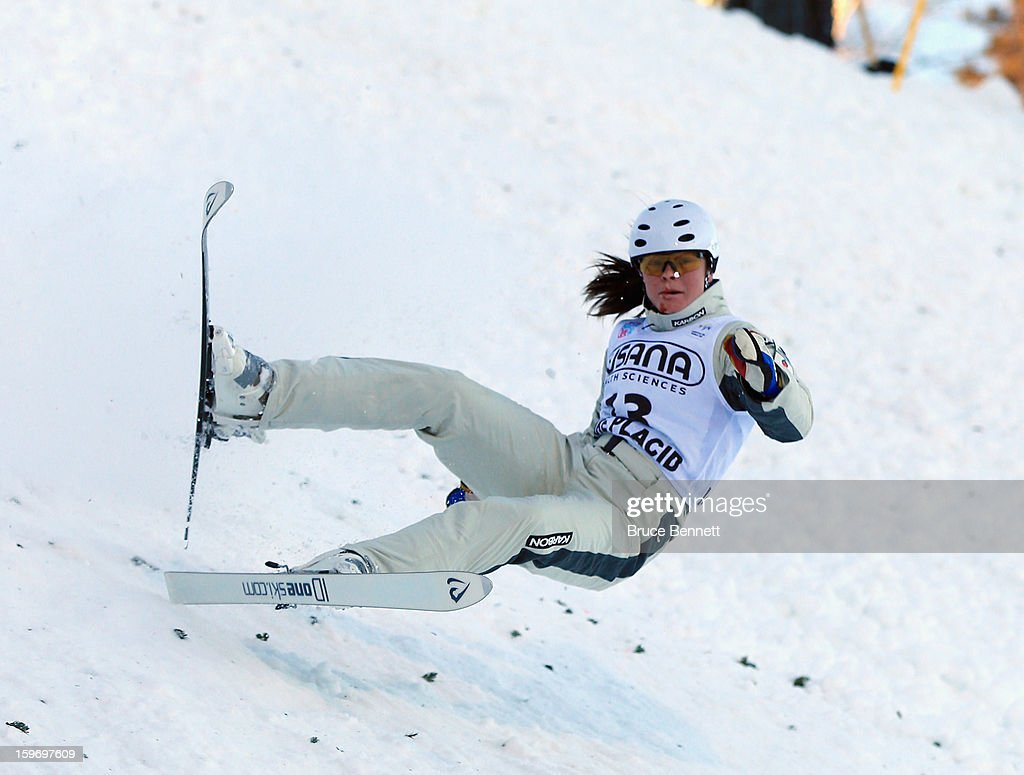 Renee McElduff #13 of Austria takes a spill in the qualification round of the USANA Freestyle World Cup aerial competition at the Lake Placid Olympic Jumping Complex on January 18, 2013 in Lake Placid, New York.