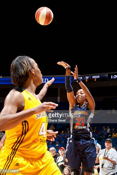 Renee Mongomery of the Connecticut Sun fires a shot as Amber Holt of the Tulsa Shock during the WNBA game on August 28 2011 at the BOK Center in...