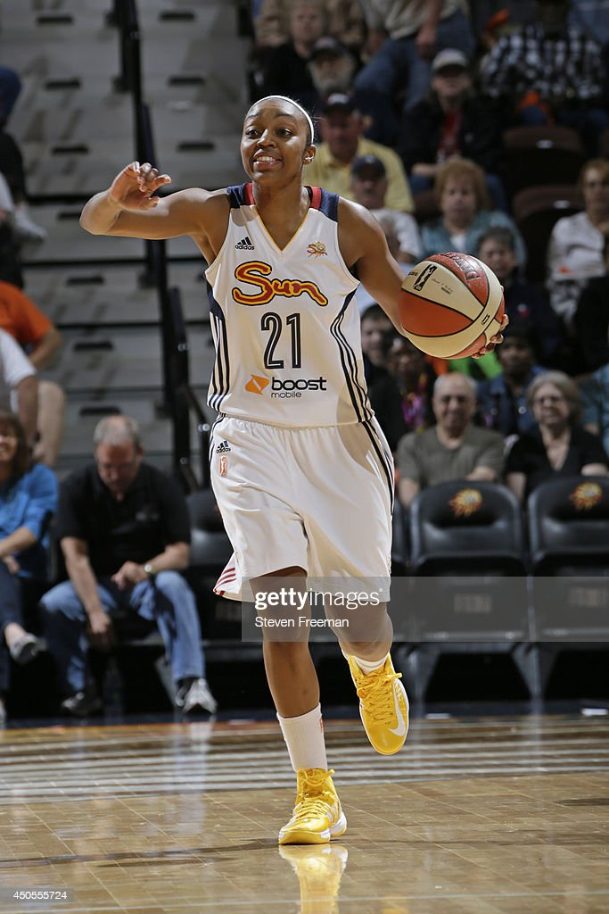 Renee Montgomery #21 of the Connecticut Sun dribbles the ball against the Phoenix Mercury on June 12, 2014 at Mohegan Sun Arena in Uncasville, Connecticut.