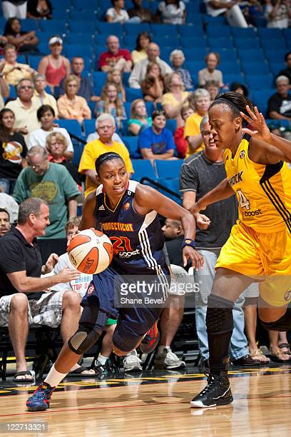 Renee Montgomery of the Connecticut Sun drives past Amber Holt of the Tulsa Shock during the WNBA game on August 28 2011 at the BOK Center in Tulsa...