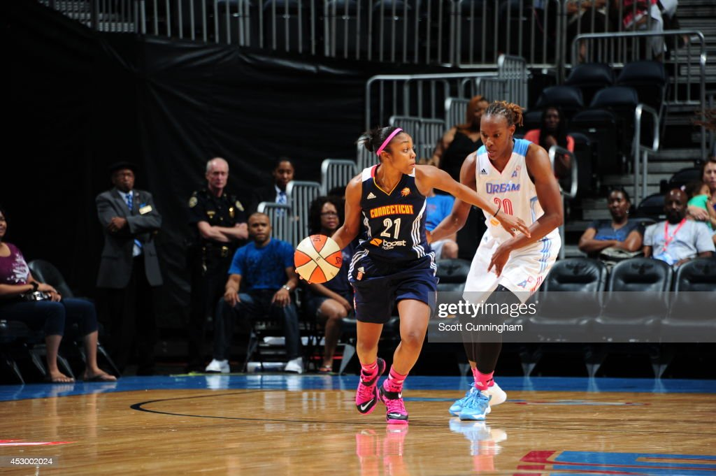 Renee Montgomery #21 of the Connecticut Sun handles the ball against Sancho Lyttle #20 of the Atlanta Dream on July 29, 2014 at Philips Arena in Atlanta, Georgia.