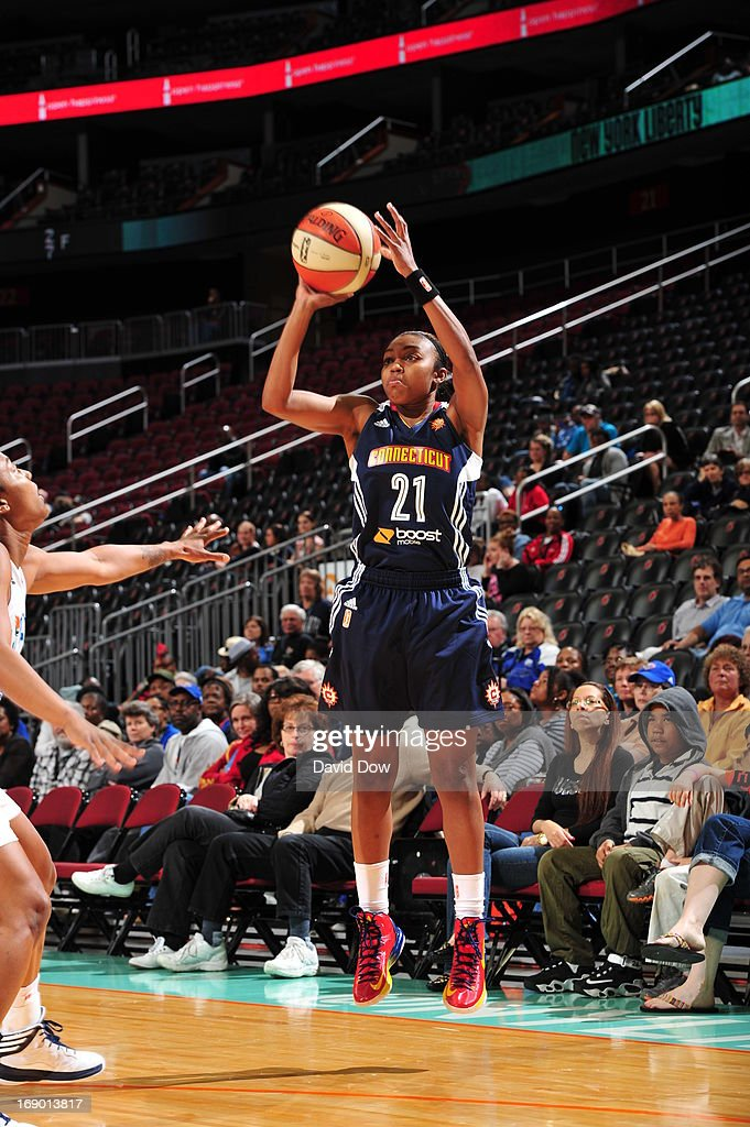 Renee Montgomery #21 of the Connecticut Sun shoots against the New York Liberty during the WNBA game on May 18, 2013 at the Prudential Center in Newark, New Jersey.