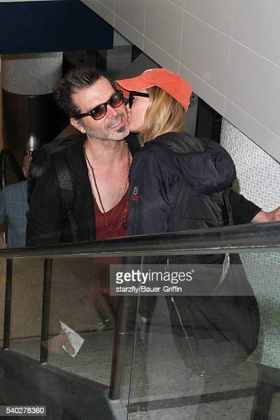 Renee Zellweger and Doyle Bramhall are seen at LAX on June 14 2016 in Los Angeles California