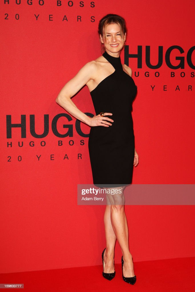 <a gi-track='captionPersonalityLinkClicked' href=/galleries/search?phrase=Renee+Zellweger&family=editorial&specificpeople=171818 ng-click='$event.stopPropagation()'>Renee Zellweger</a> attends Hugo By Hugo Boss Autumn/Winter 2013/14 fashion show during Mercedes-Benz Fashion Week Berlin at The Brandenburg Gate on January 17, 2013 in Berlin, Germany.