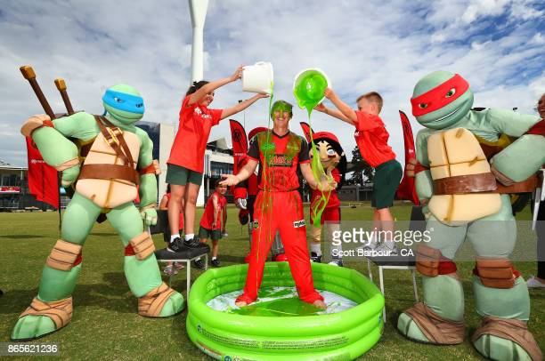 Renegades BBL player Brad Hogg is slimed as the Teenage Mutant Ninja Turtles look on during a Melbourne Renegades media opportunity at Kardinia Park...