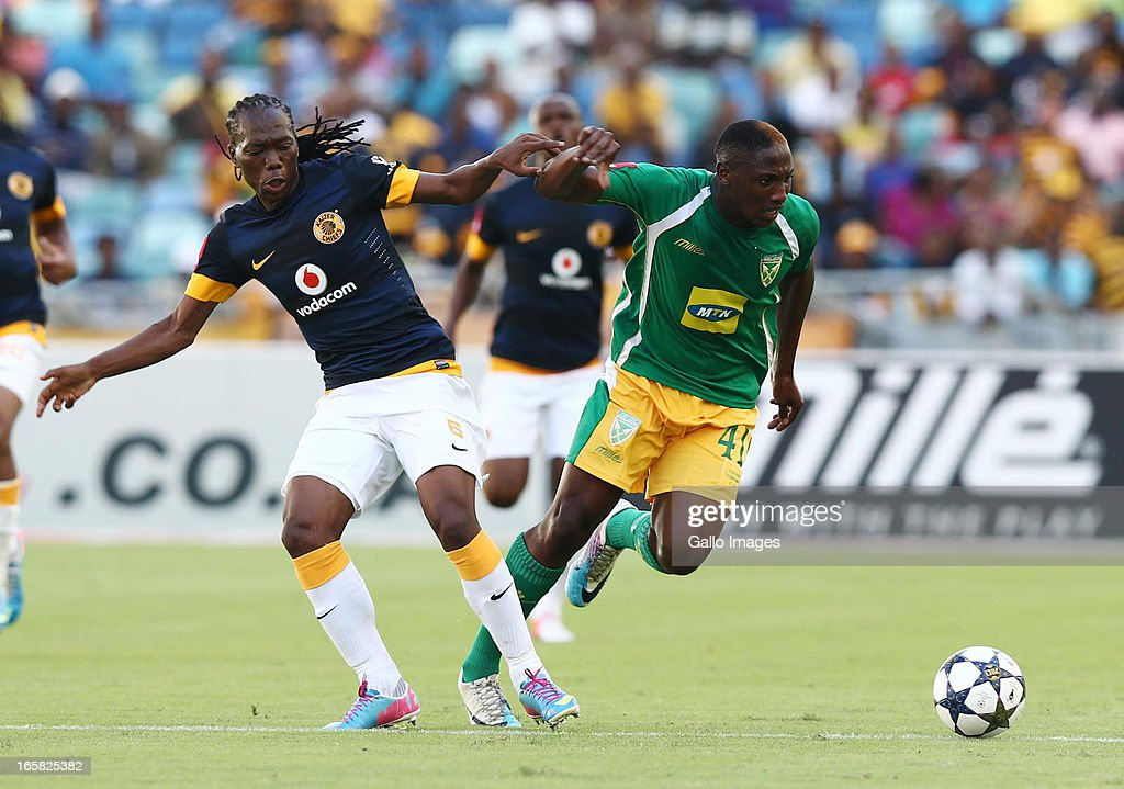 Reneilwe Letsholonyane battles with Lucky Nguzana during the Absa Premiership match between Golden Arrows and Kaizer Chiefs at Moses Mabhida Stadium on April 06, 2013 in Durban, South Africa.