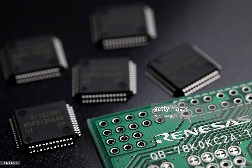 A Renesas Electronics Corp. central processing unit (CPU) board and microcontrollers are arranged for a photograph in Soka City, Saitama Prefecture, Japan, on Saturday, June 23, 2012. Renesas said it reached a basic agreement to receive support from its largest shareholders, while the company's major lenders will provide additional funding, as it seeks to recover from losses. Photographer: Kiyoshi Ota/Bloomberg via Getty Images