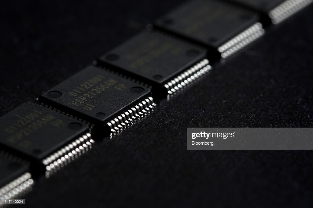 Renesas Electronics Corp. microcontrollers are arranged for a photograph in Soka City, Saitama Prefecture, Japan, on Saturday, June 23, 2012. Renesas said it reached a basic agreement to receive support from its largest shareholders, while the company's major lenders will provide additional funding, as it seeks to recover from losses. Photographer: Kiyoshi Ota/Bloomberg via Getty Images