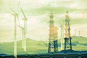 Renewable energy concept. Double exposure of Wind mill and?transmission towers.