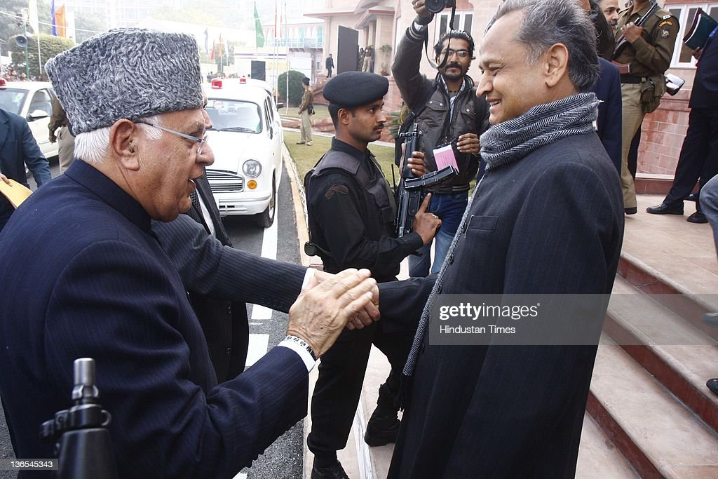 Renewable Energy Minister <a gi-track='captionPersonalityLinkClicked' href=/galleries/search?phrase=Farooq+Abdullah&family=editorial&specificpeople=2291127 ng-click='$event.stopPropagation()'>Farooq Abdullah</a> is welcomed by Rajasthan CM Ashok Gehlot on the first day of the Prawasi Bharatiya Diwas at Birla Auditorium on January 7, 2012 in Jaipur, India. Around 1,300 delegates from NRI community spread all over the world will attend the three day convention aimed at connecting Indian Diaspora to their roots and utilizing their synergies to propel the prosperity of India.