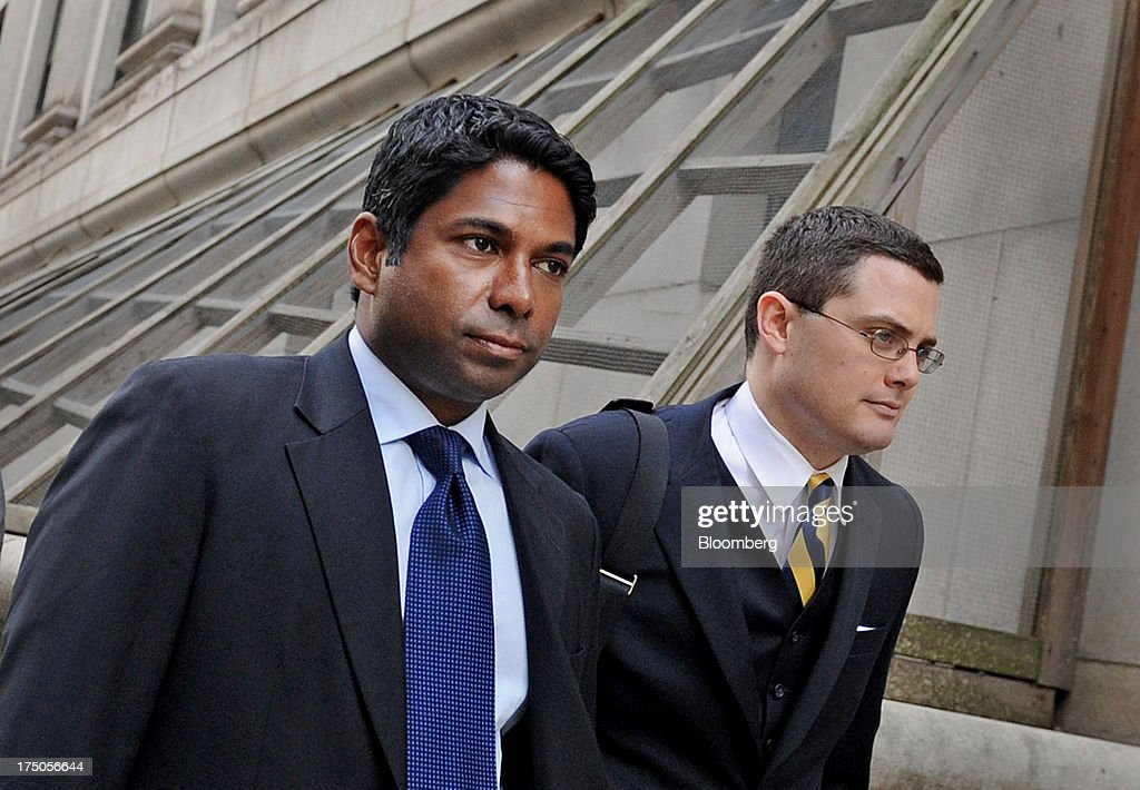 Rengan Rajaratnam, founder of Sedna Capital Management LLC and younger brother of imprisoned hedge-fund founder Raj Rajaratnam, left, exits federal court with his attorney John Mateus in New York, U.S., on Tuesday, July 30, 2013. Rengan was charged for his part in an insider trading scheme tied to his brother's fund the Galleon Group LLC. Photographer: Louis Lanzano/Bloomberg via Getty Images