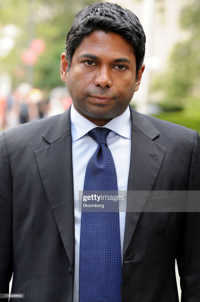 Rengan Rajaratnam, founder of Sedna Capital Management LLC and younger brother of imprisoned hedge-fund founder Raj Rajaratnam, exits federal court in New York, U.S., on Tuesday, July 30, 2013. Rengan was charged for his part in an insider trading scheme tied to his brother's fund the Galleon Group LLC. Photographer: Louis Lanzano/Bloomberg via Getty Images