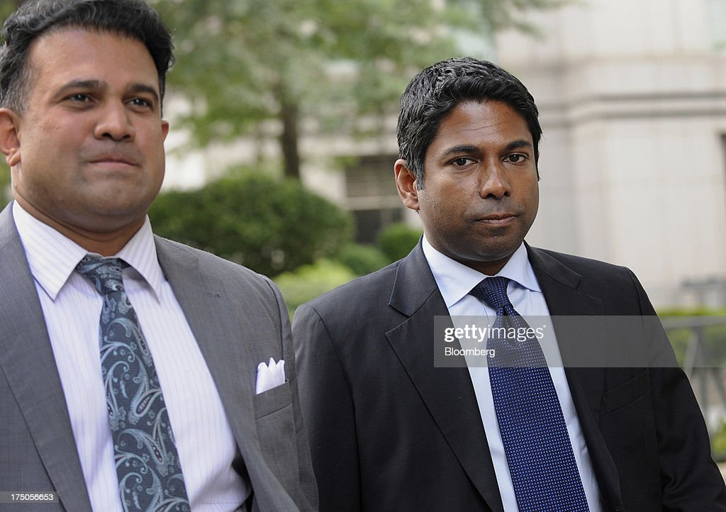 Rengan Rajaratnam, founder of Sedna Capital Management LLC and younger brother of imprisoned hedge-fund founder Raj Rajaratnam, right, exits federal court with his attorney Vinoo Varghese in New York, U.S., on Tuesday, July 30, 2013. Rengan was charged for his part in an insider trading scheme tied to his brother's fund the Galleon Group LLC. Photographer: Louis Lanzano/Bloomberg via Getty Images