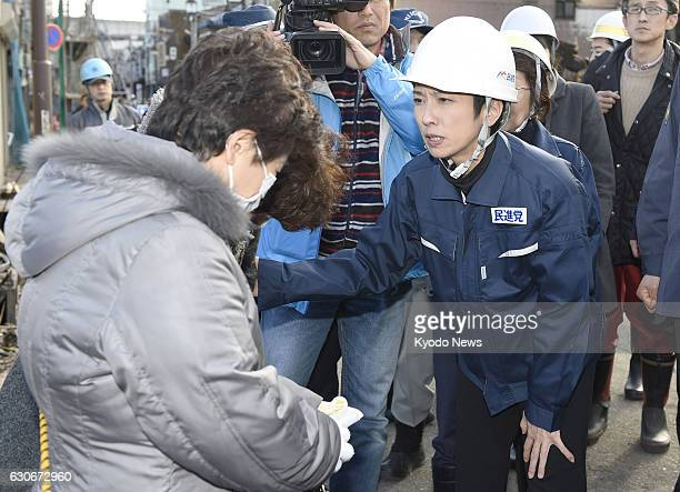 Renho head of Japan's main opposition Democratic Party consoles a local resident in the Sea of Japan coastal city of Itoigawa Niigata Prefecture on...