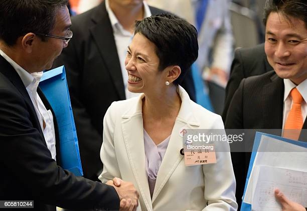 Renho Murata presidentelect of the Democratic Party of Japan center greets attendees following the party's leadership election in Tokyo Japan on...