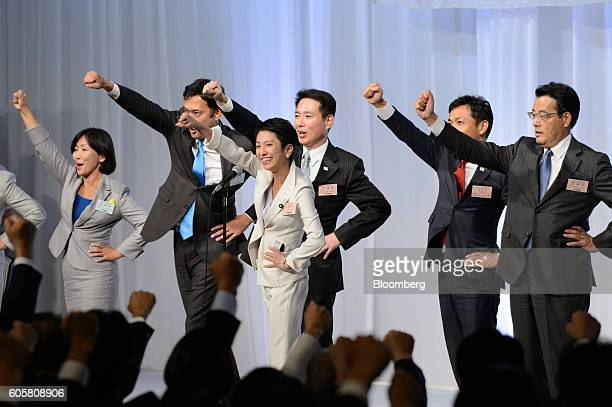 Renho Murata presidentelect of the Democratic Party of Japan fourth right gestures following the party's leadership election in Tokyo Japan on...