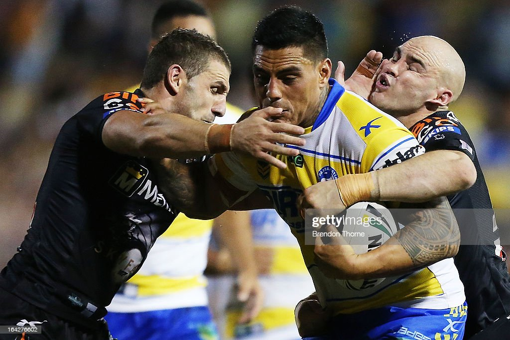 Reni Maitua of the Eels is tackled by Robbie Farah and Liam Fulton of the Tigers during the round three NRL match between the Wests Tigers and the Parramatta Eels at Leichhardt Oval on March 22, 2013 in Sydney, Australia.