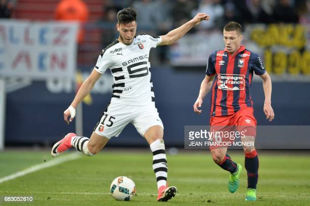 Rennes' Algerian defender Ramy Bensebaini vies with Caen's French midfielder Jonathan Delaplace during the French L1 football match between Caen and...