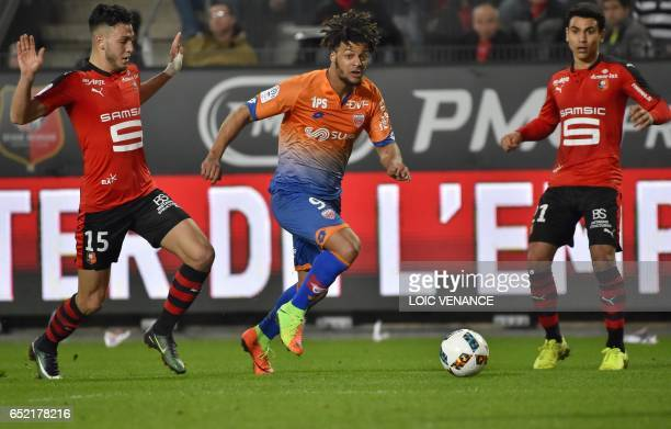 Rennes' Algerian defender Ramy Bensebaini vies with Dijon's French forward Lois Diony during the French L1 football match Rennes vs Dijon at the...