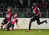 Rennes' Austrian forward Philipp Hosiner celebrtaes with teammates after scoring during the French league Cup football match Rennes against Marseille...