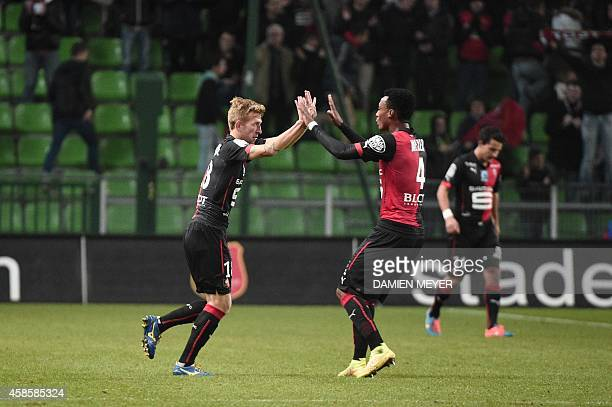 Rennes' Brazilian midfielder Pedro Henrique celebrates with Rennes' Mozambican defender Edson Mexer after scoring a goal during the French L1...