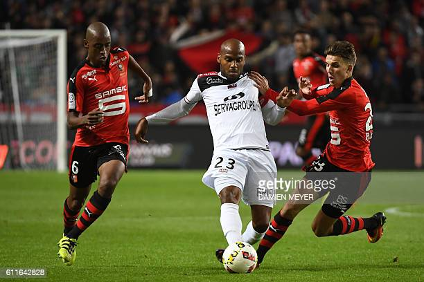 Rennes' Cape Verdean midfielder Gelson Fernandes Guingamp's French forward Jimmy Briand and Rennes' French midfielder Adrien Hounu fight for the ball...
